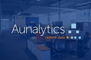 Aunalytics logo with office in background